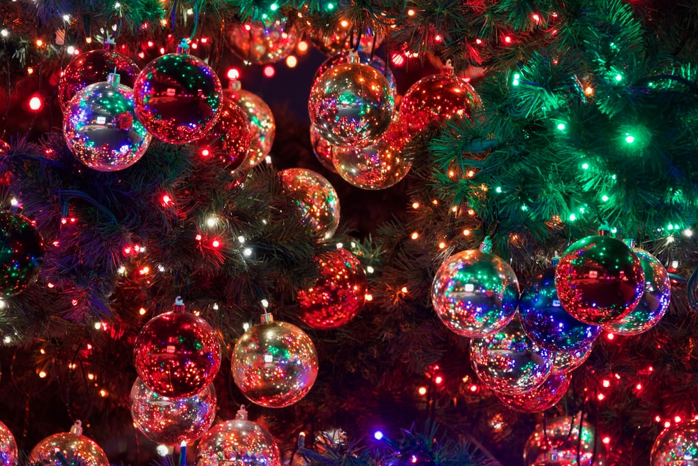 baubles on Christmas tree with turned-on lights