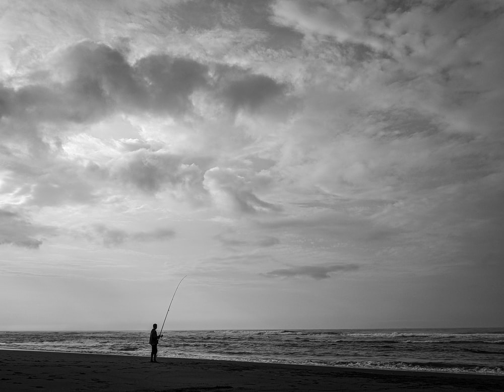 person fishing on body of water