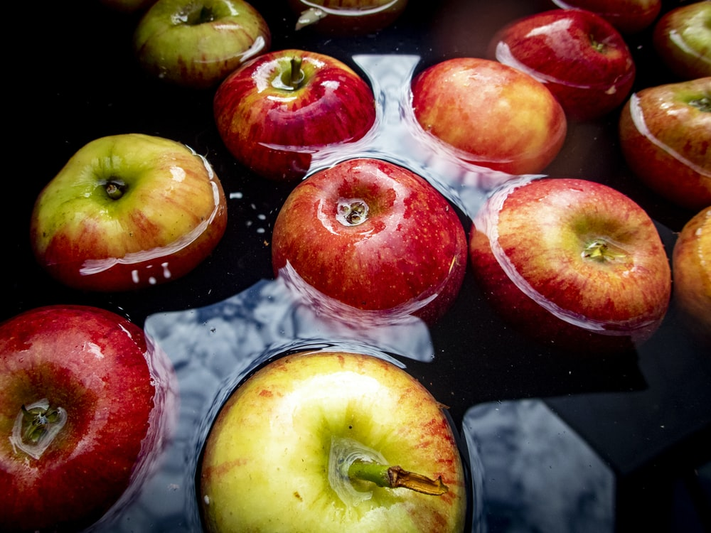 red and yellow apples floating on water