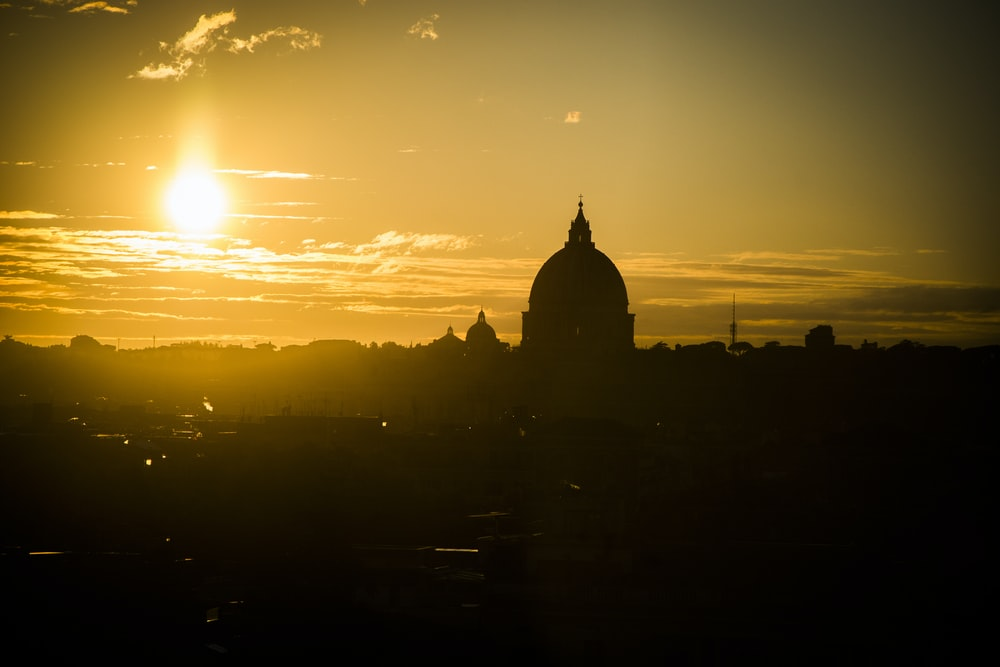 silhouette of dome building during sunrise