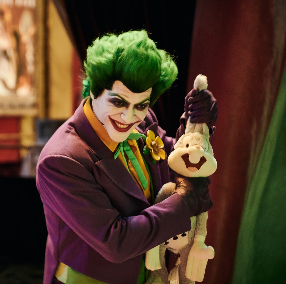 man wearing The Joker costume