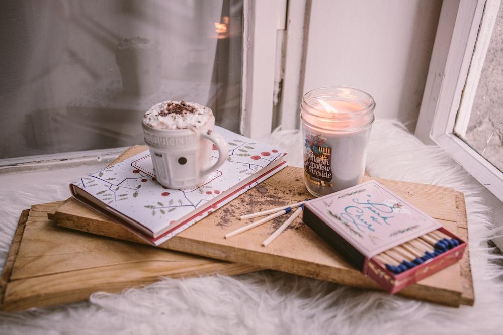 dessert mug on book