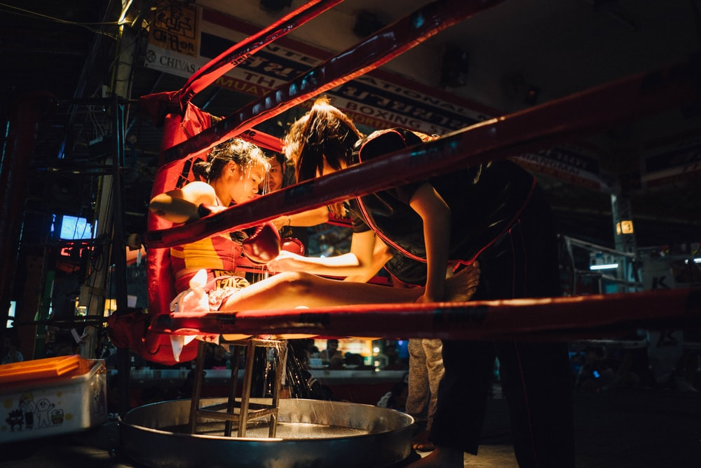 girl sitting on chair inside boxing ring