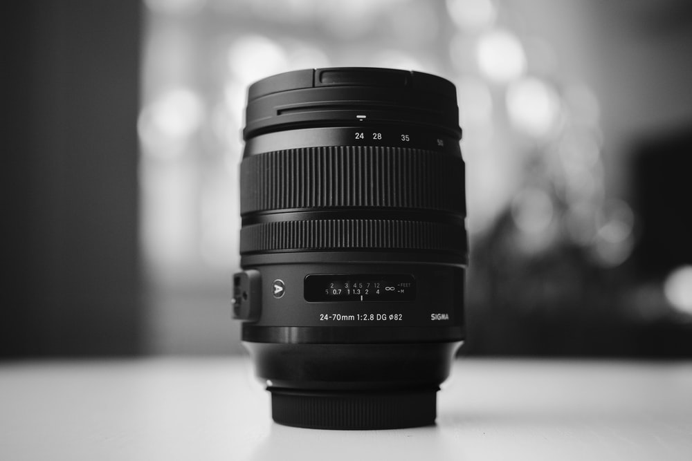 grayscale photo of DSLR camera lens