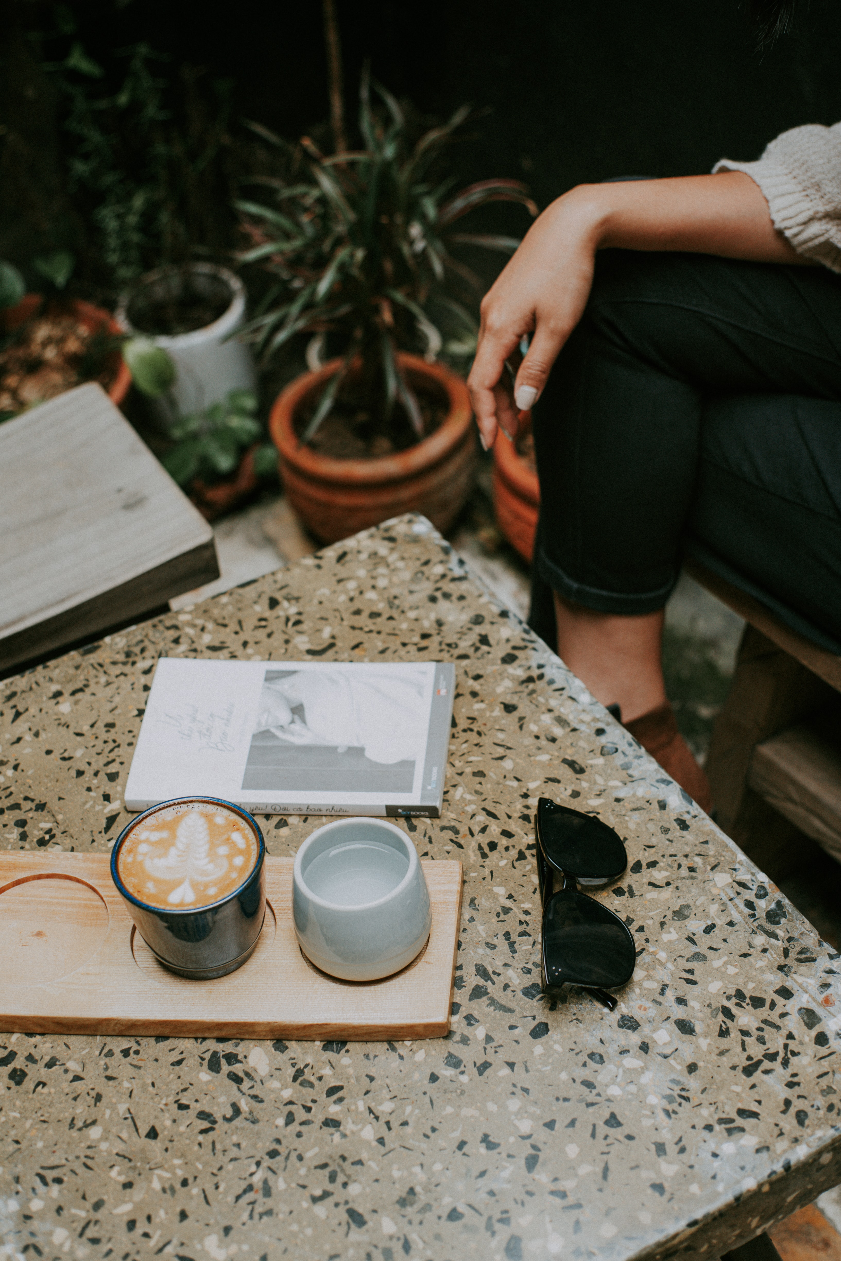 Cup Of Frappe Beside White Ceramic Mug On Brown Slab Photo Free Human Image On Unsplash
