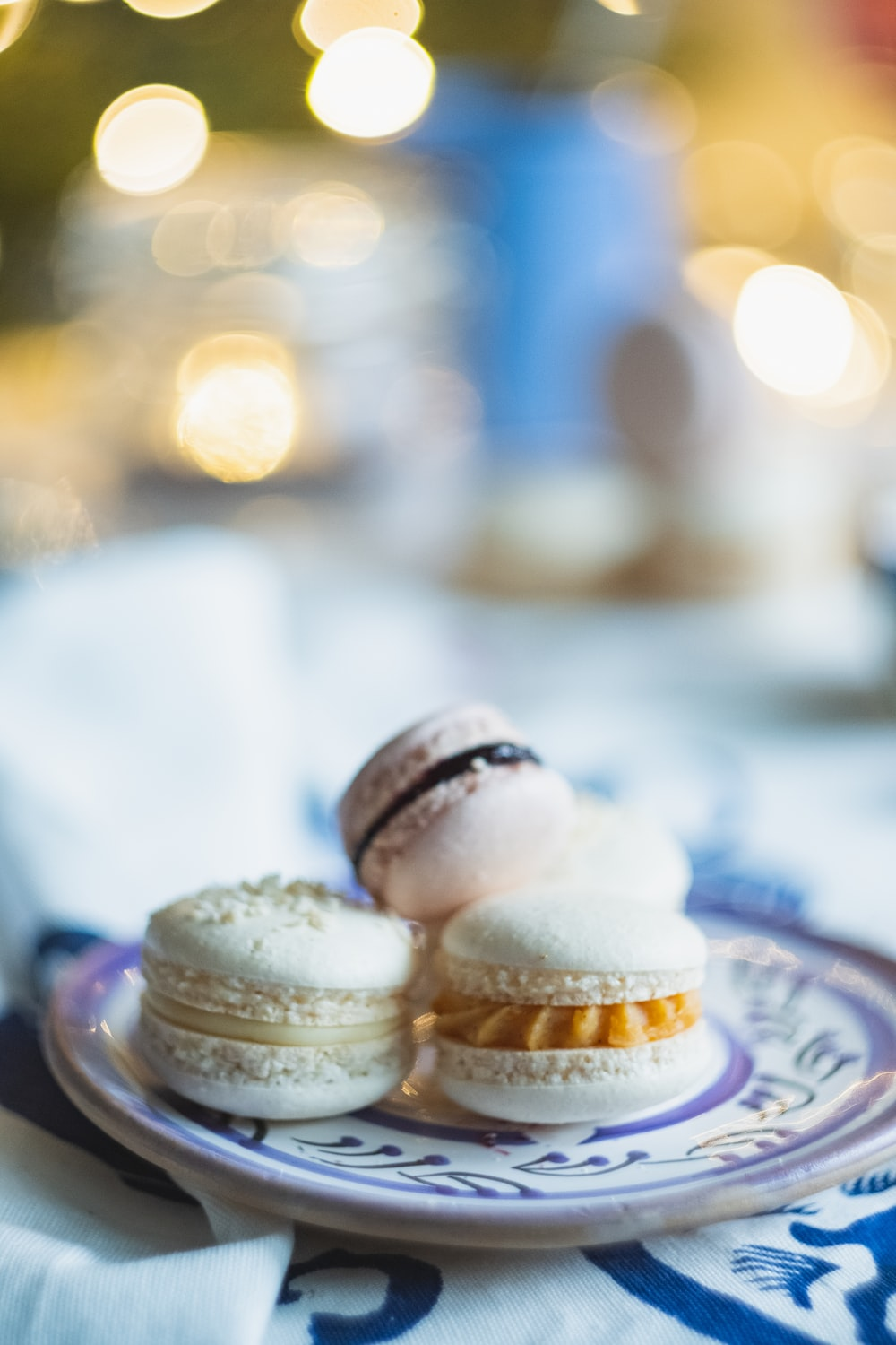 selective focus photo of macarons on purple plate