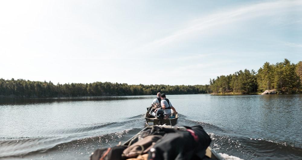 people riding canoe boat