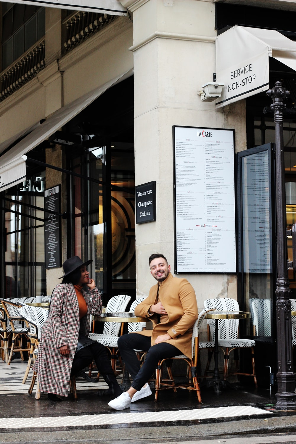 man and woman sitting in a coffee shop