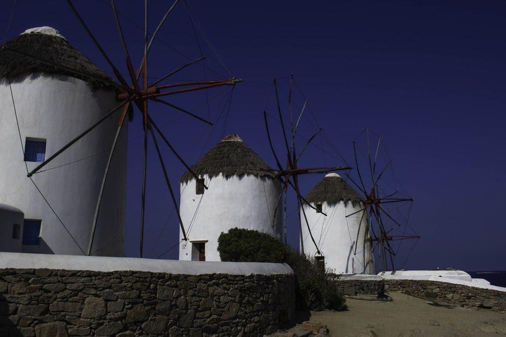 photo of concrete house with windmill