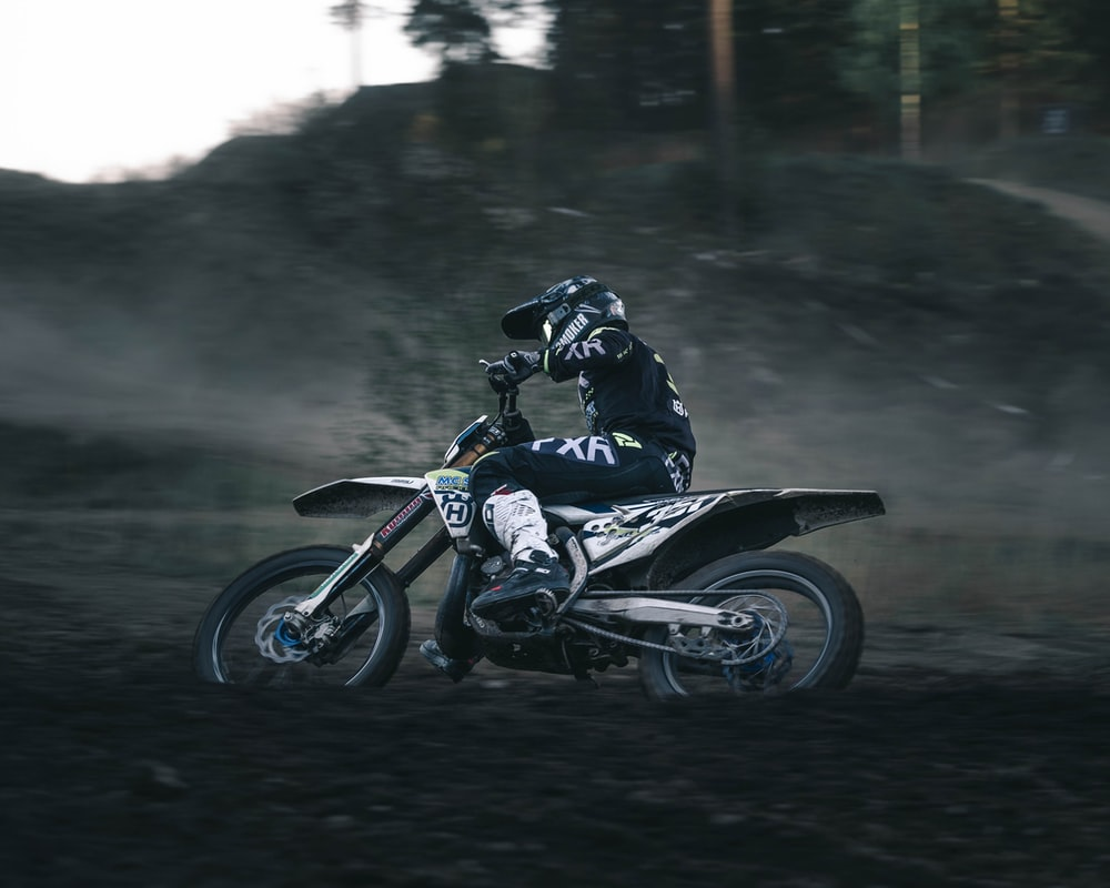 person riding motocross bike