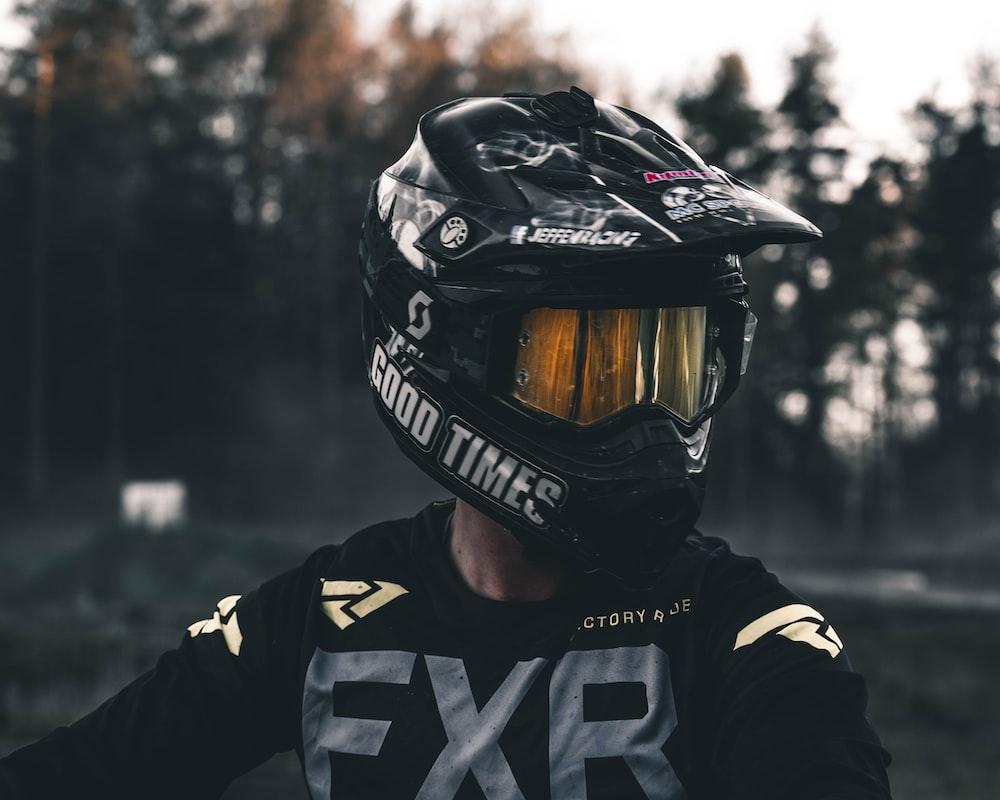 person wearing black full-face helmet