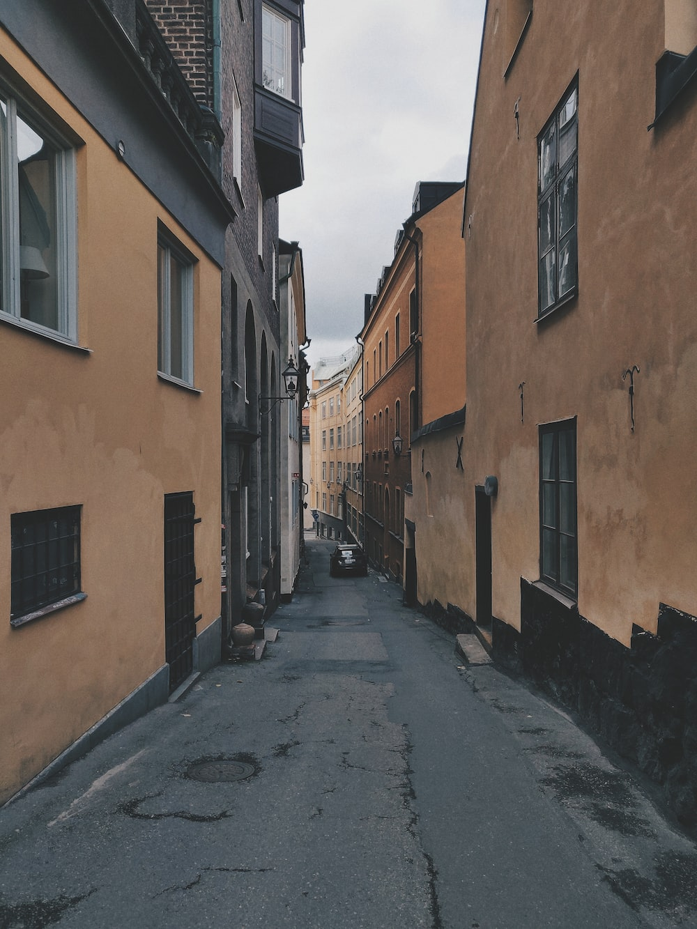 view photography of narrow road between buildngs