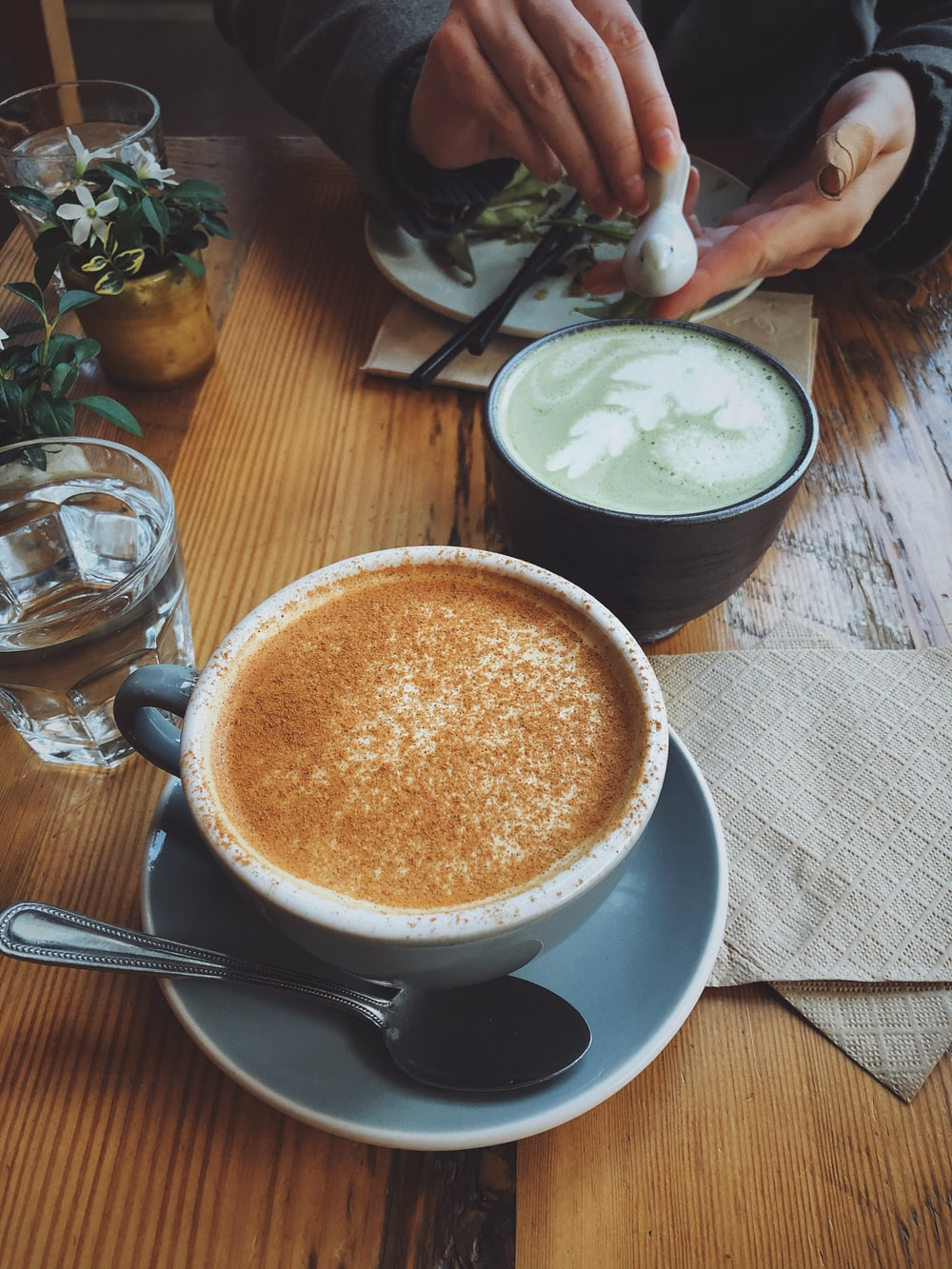 gray and white ceramic coffee cup with cappuccino