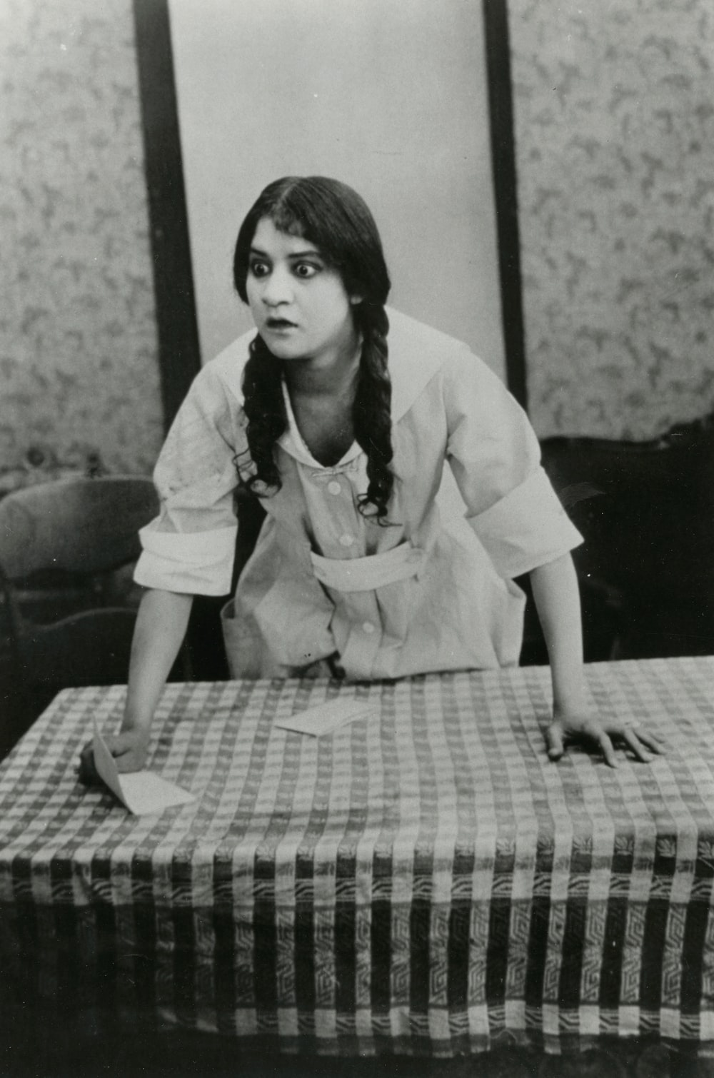 woman leaning forward on table