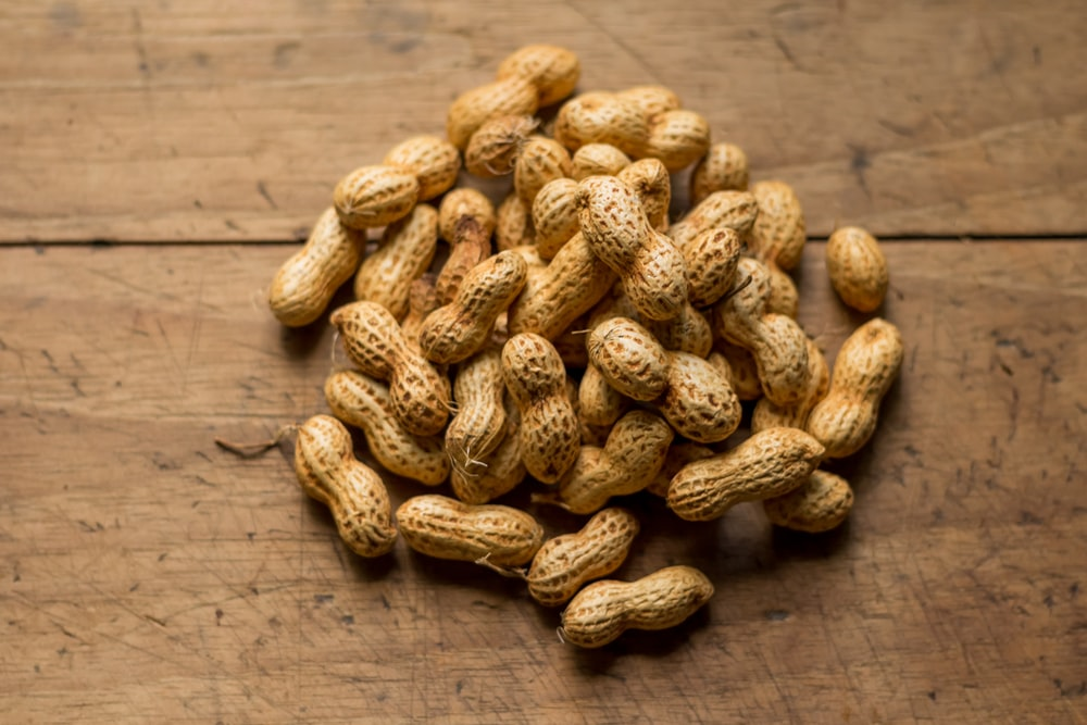 bunch of brown peanuts