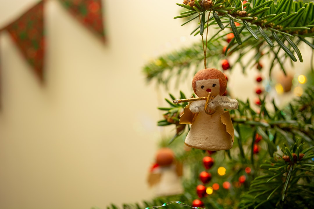 Little trumpet-playing angel on a Christmas tree