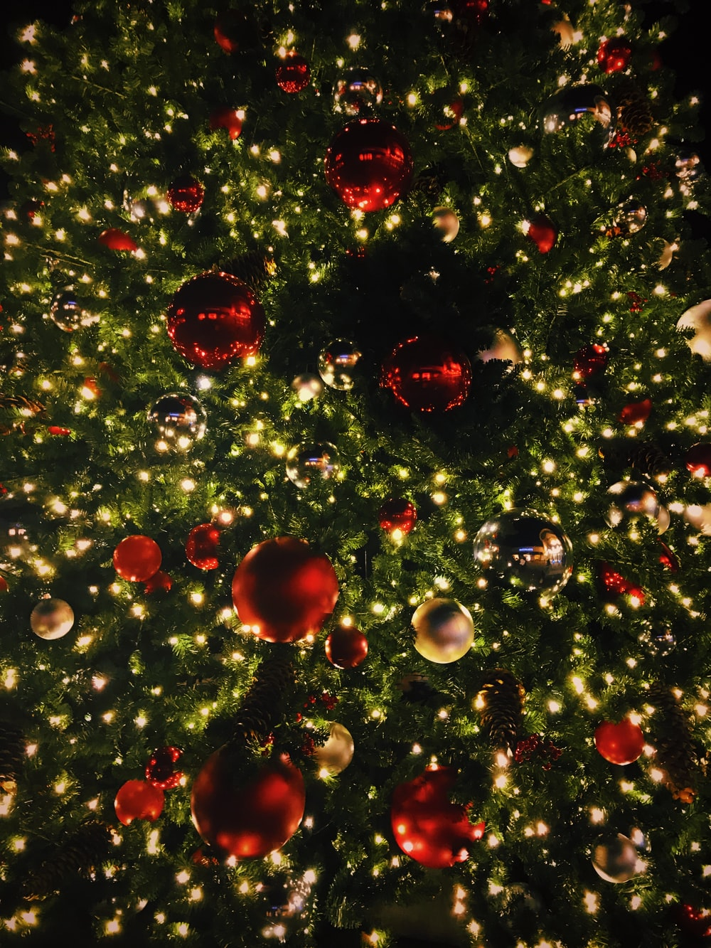 view photography of Christmas tree with baubles and lighted string lights