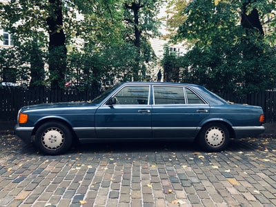 A 1980s Mercedes Benz S-Class presents itself in the timeless beauty of this immortal industrial design, as seen in the very center of Vienna near Schottenstift. Slightly color corrected.