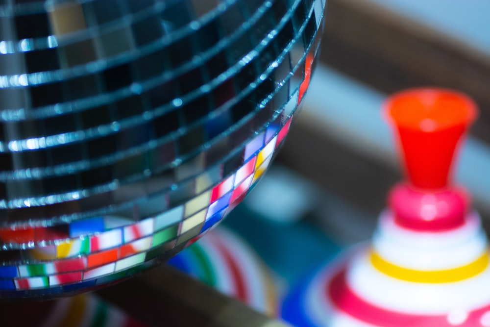 macro photography of multicolored disco ball