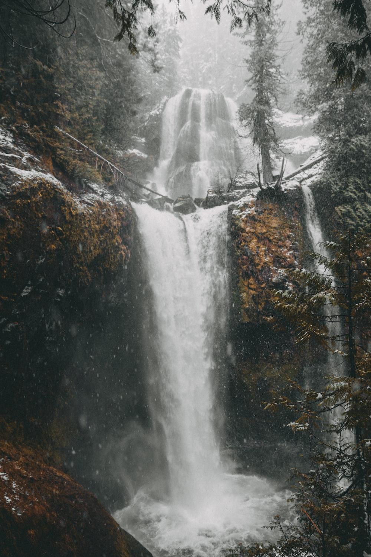 flowing waterfalls during daytime