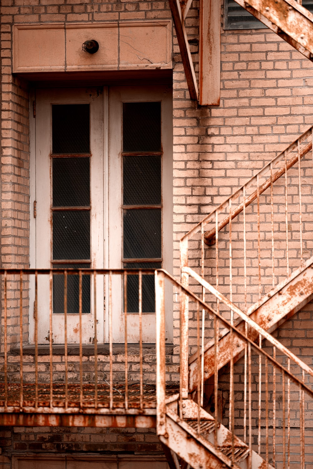 closed French doors beside stairs during day