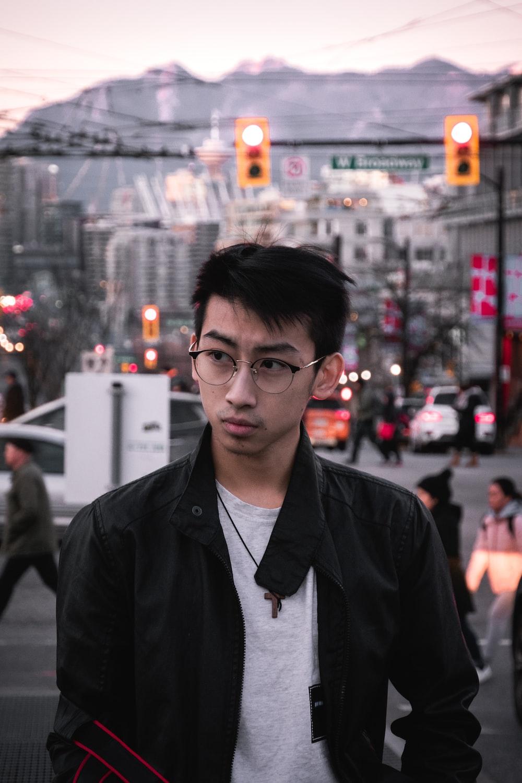 man in eyeglasses and black jacket