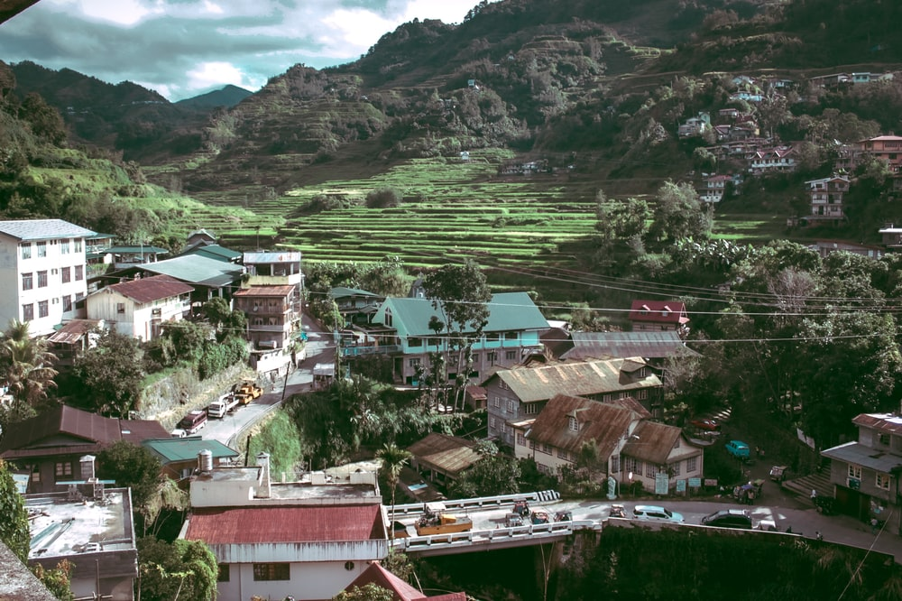 aerial photo of houses near hill