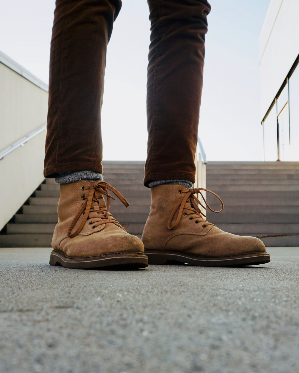 person wearing brown leather combat boots