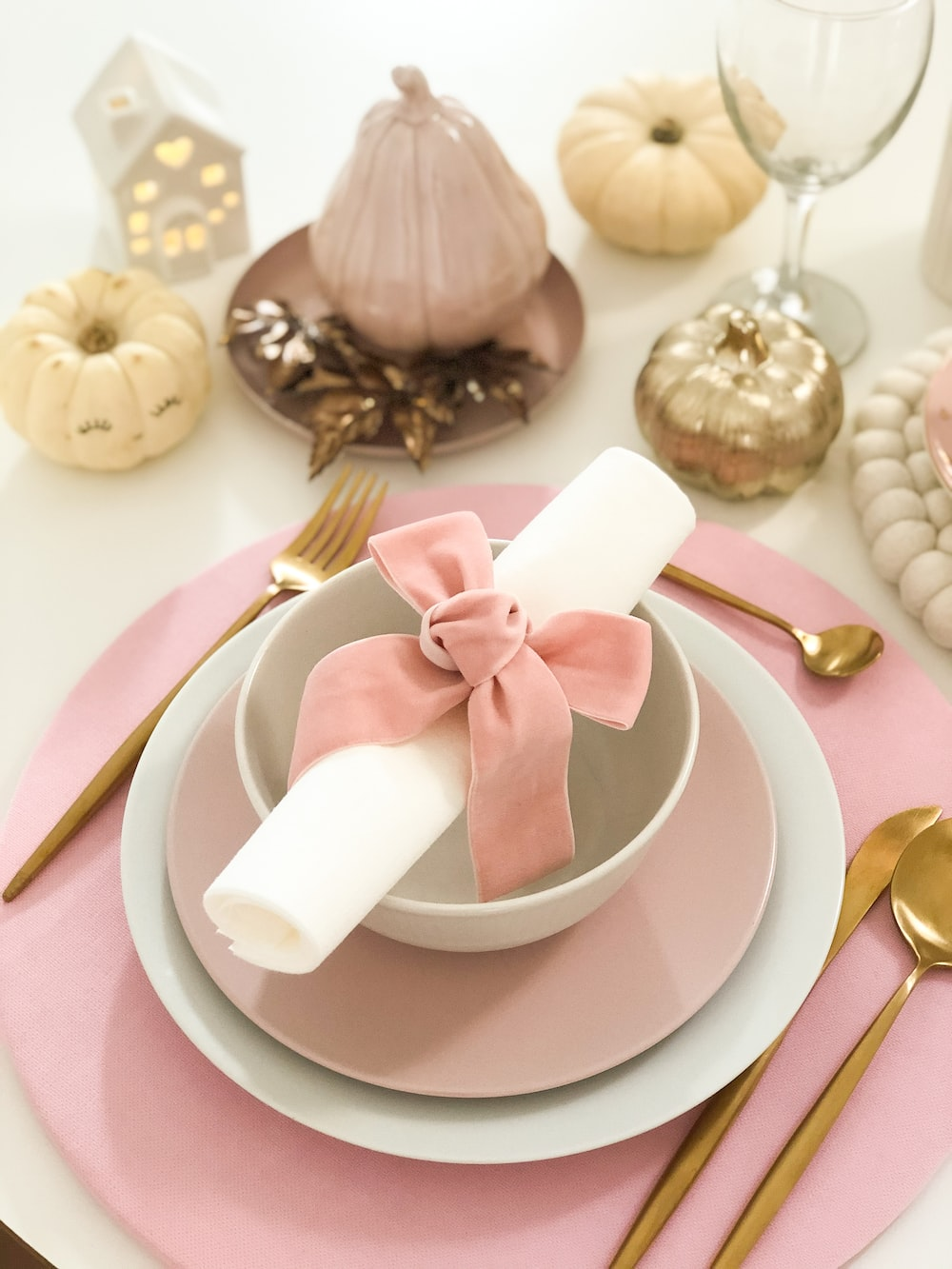 white and pink bowl and plate