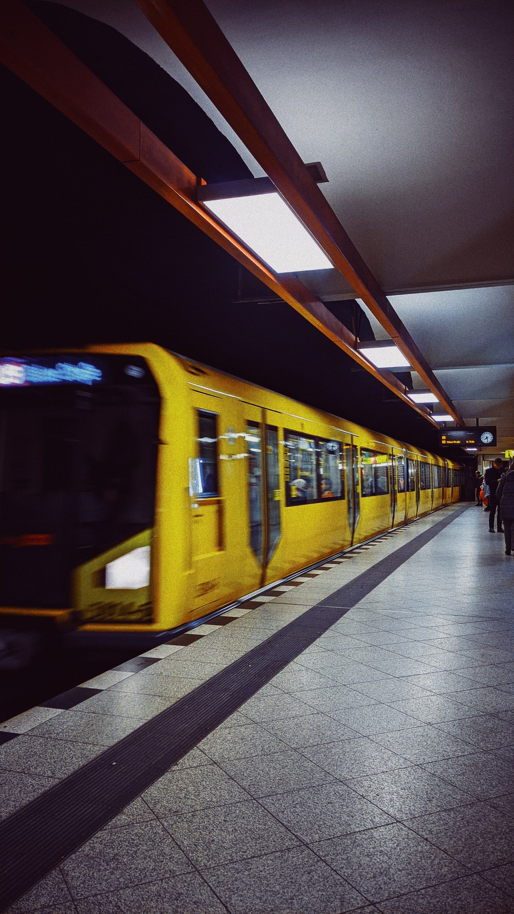 yellow train on station at night time