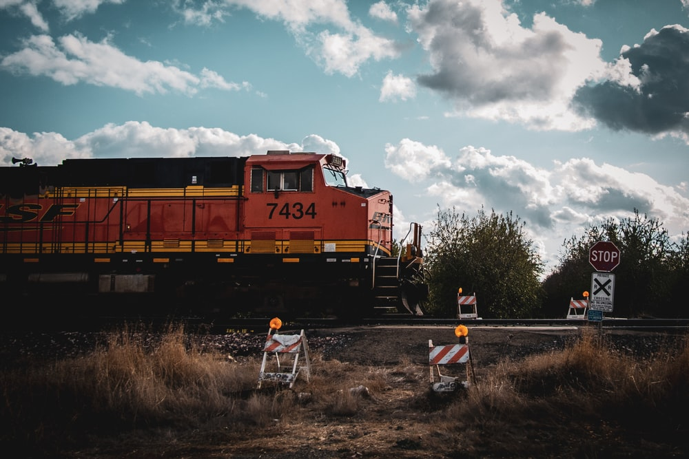 view photography of red and yellow train