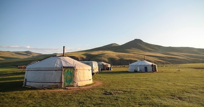 white tents on field mongolia teams background