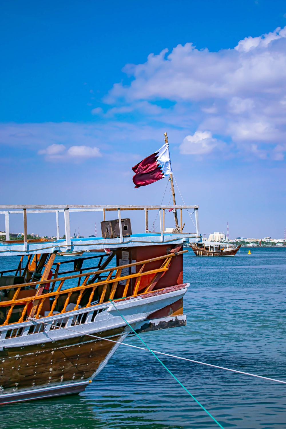 boat with red and white flag