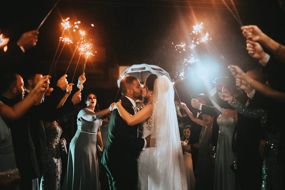 newly wed couple kissing photograph