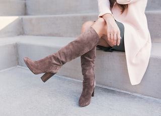 woman wearing pair of brown leather boots