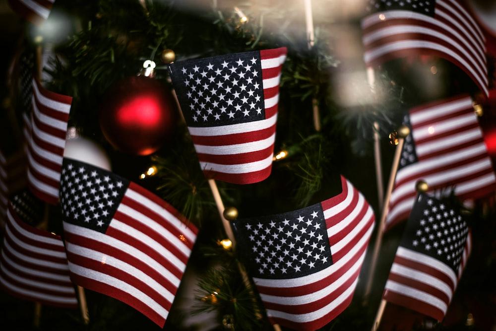 USA flaglet beside green Christmas tree