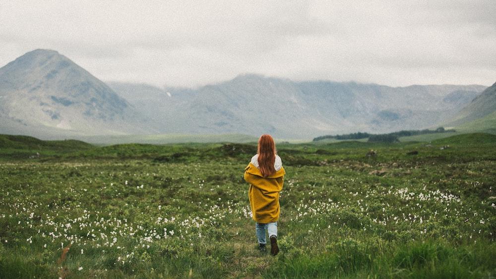 woman standing on green field