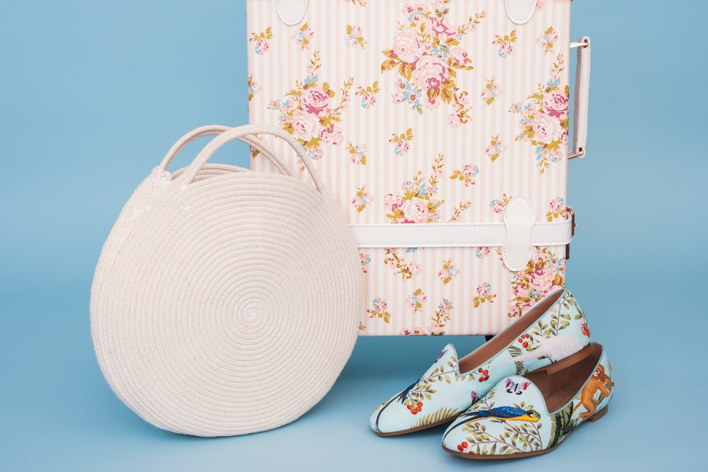 white handbag and multicolored floral flats