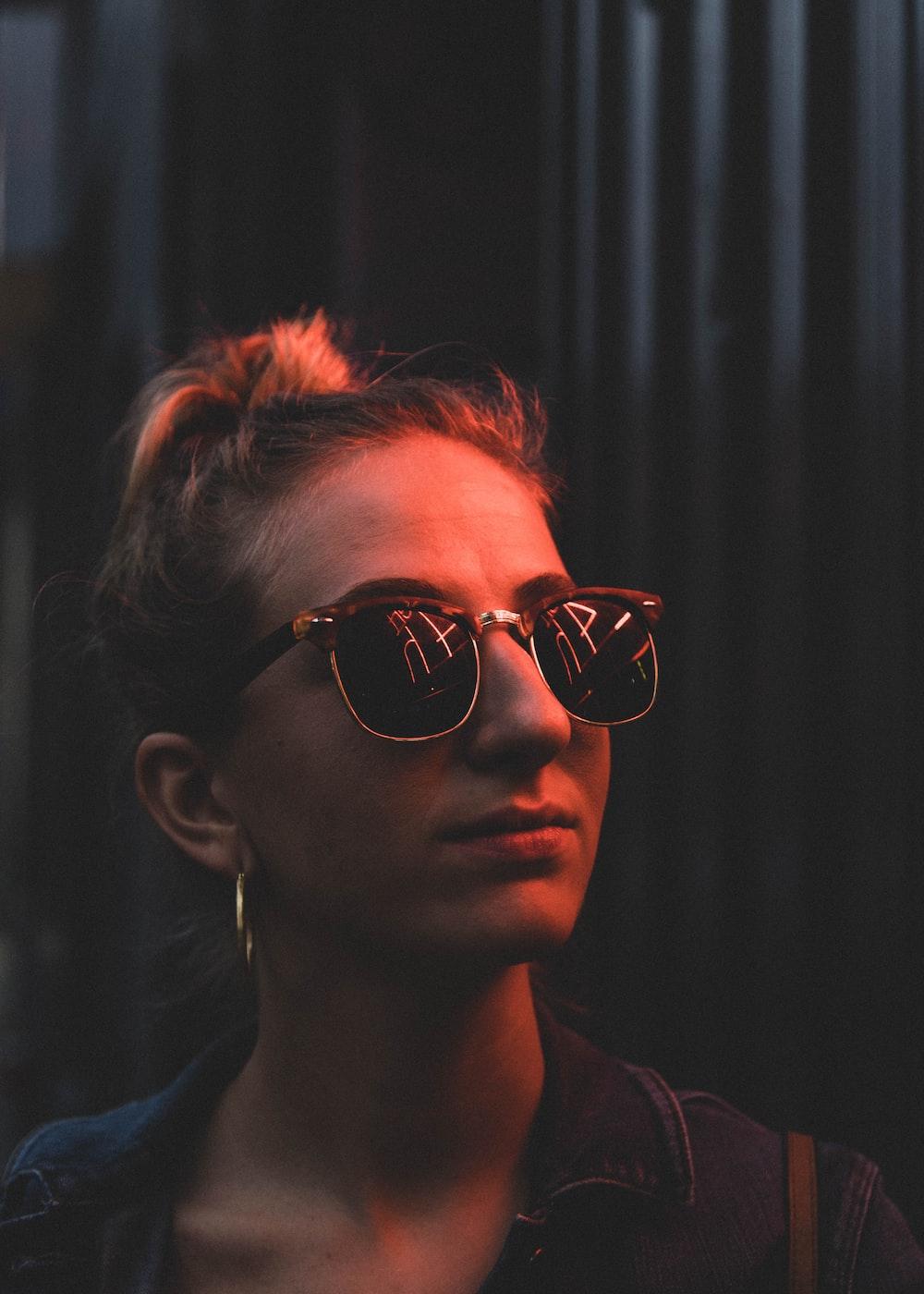 portrait of woman wearing black sunglasses