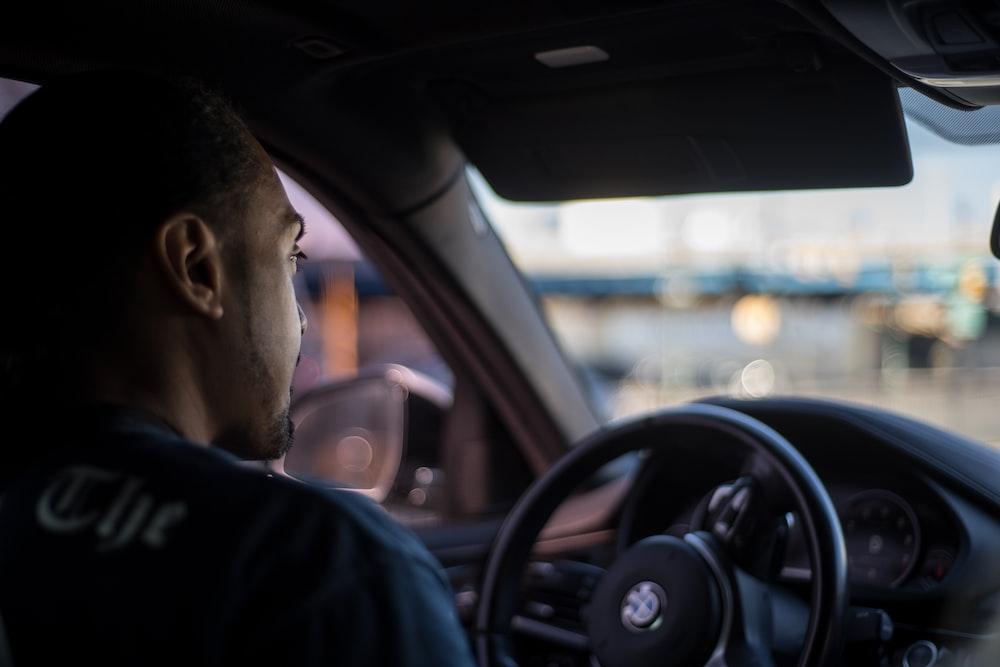 man in BMW vehicle