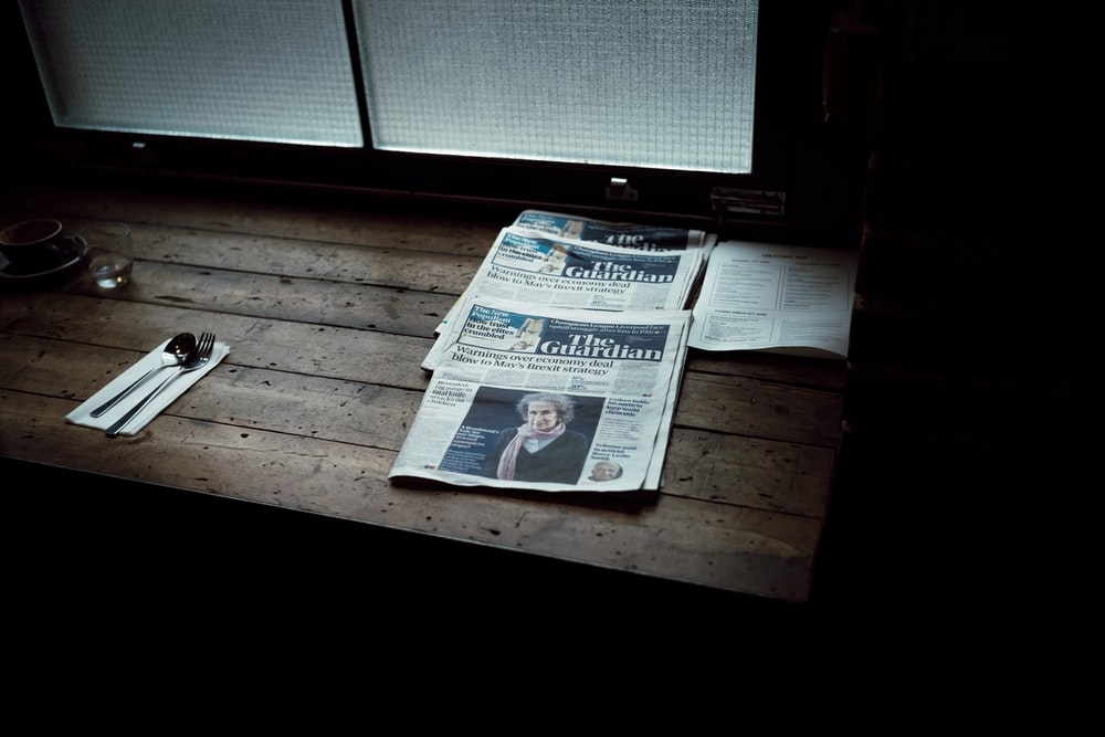 newspapers beside window