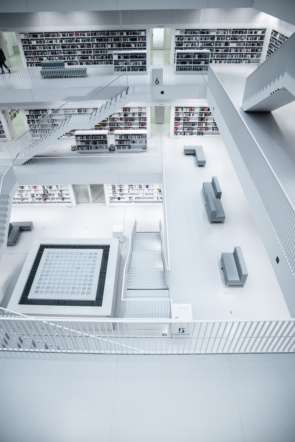 white stairs and book shelves