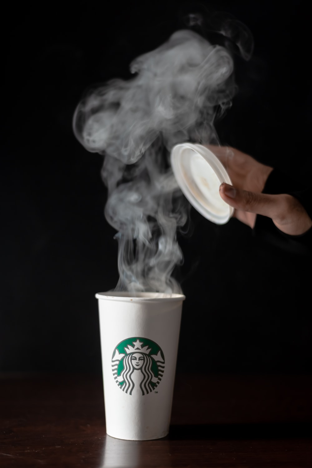 white and green Starbucks coffee cup
