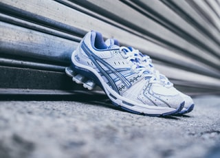 pair of white-and-purple Asics sneakers