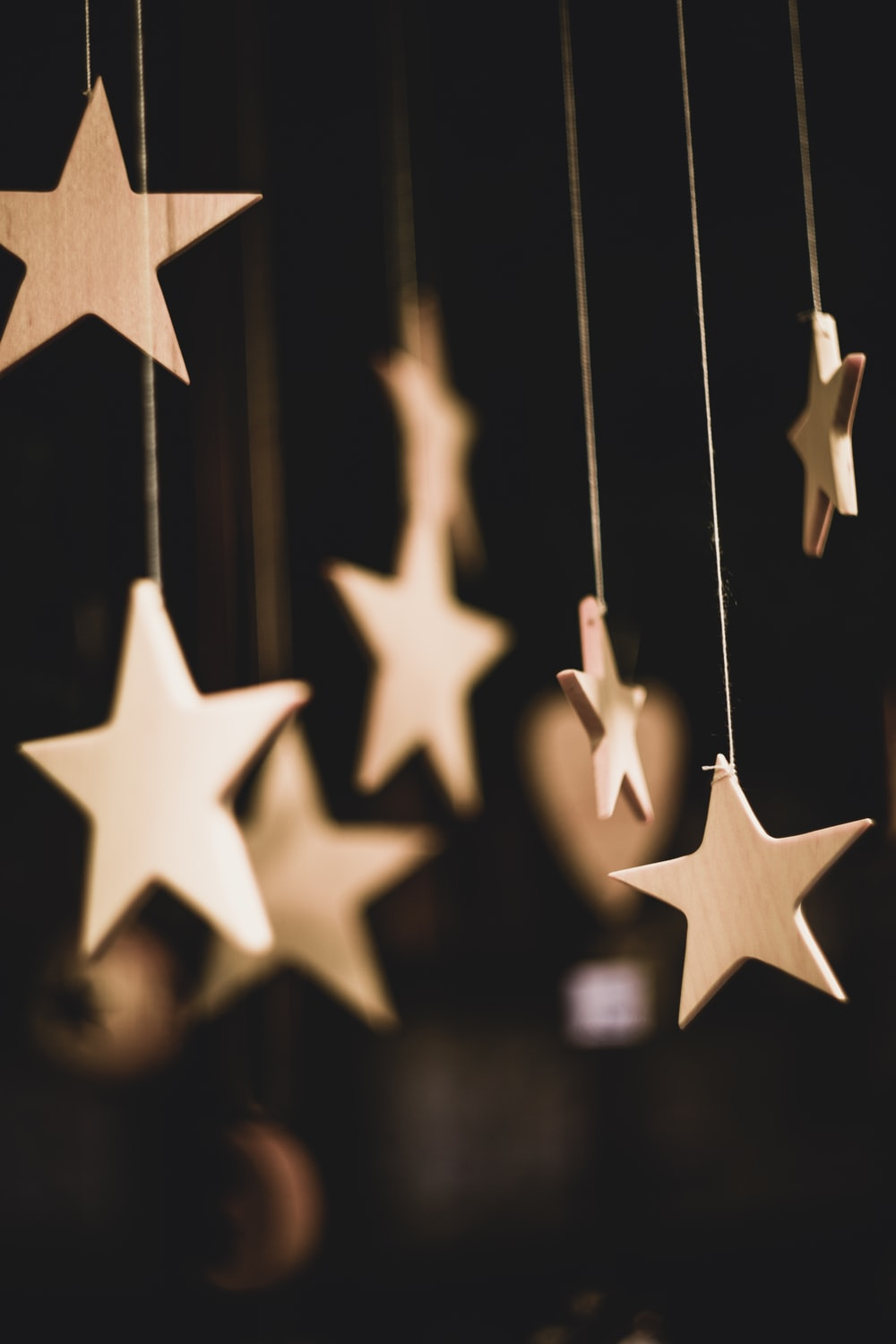 shallow focus photo of wooden stars hanging decor