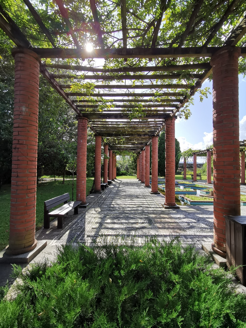 brown pillar garden arch