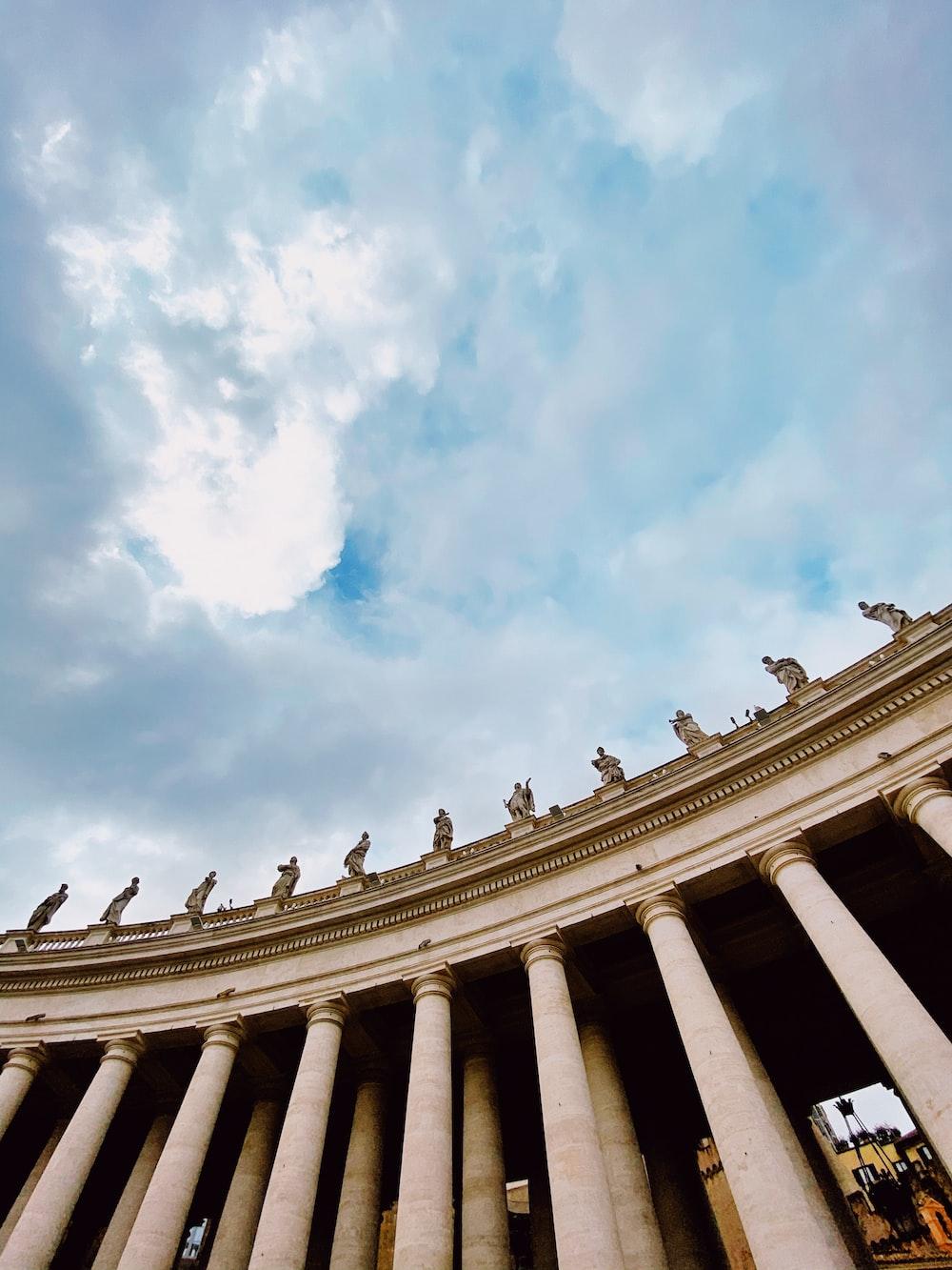 Corinthians columns under white clouds