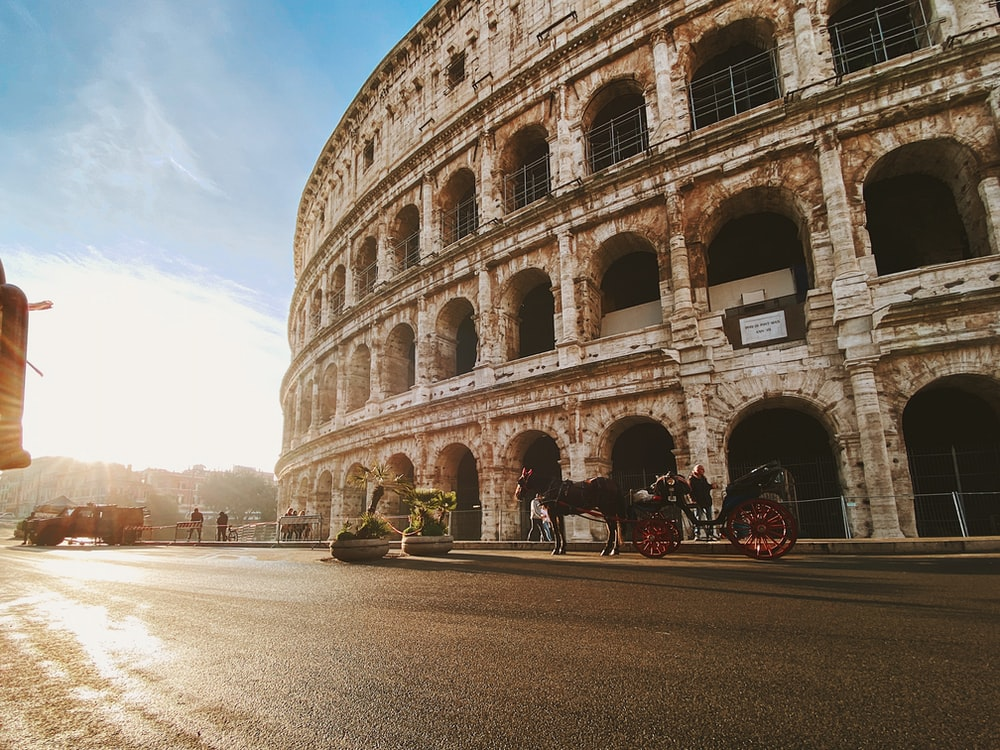 horse and carriage beside The Colosseum