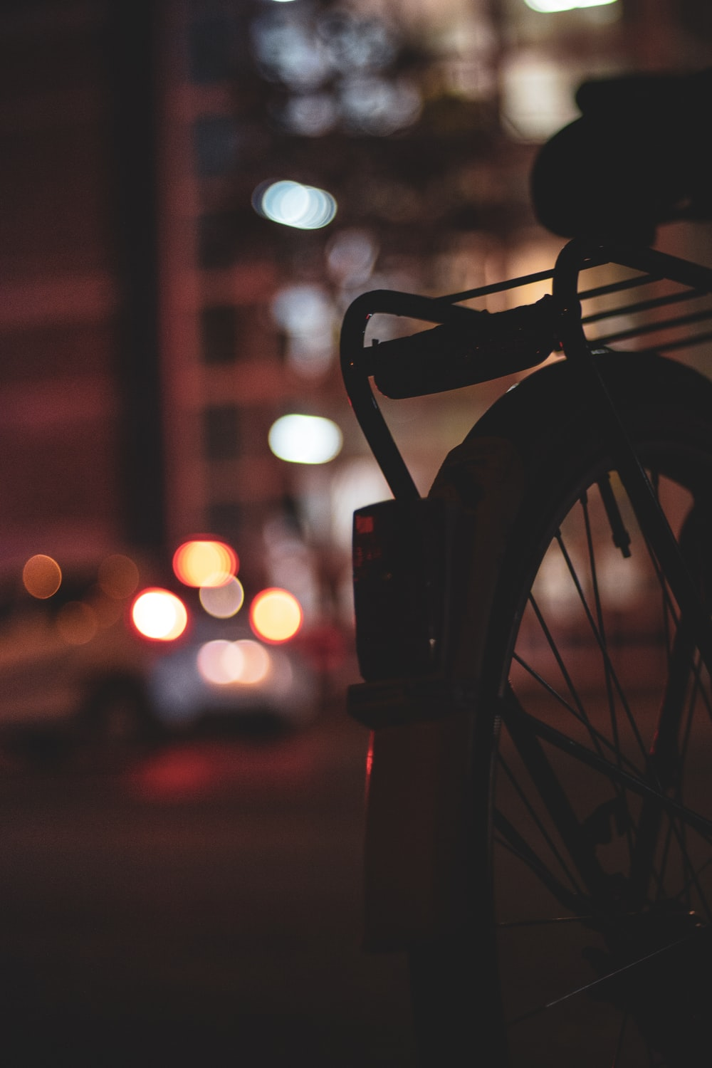 silhouette photo of bicycle with bokeh effect