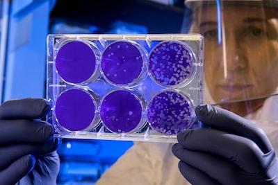 woman holding laboratory appratus virus zoom background